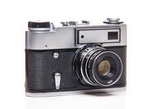 Gammal parallell kamera för klassiker 35mm på vit Arkivfoton
