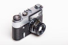 Gammal parallell kamera för klassiker 35mm på vit Royaltyfri Foto