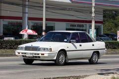 Gammal personbil, Mitsubishi Galant fotografering för bildbyråer