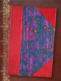 Gammal röd och blå bok arkivbilder