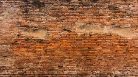 Gammal röd och orange tegelstenvägg Arkivfoto