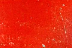 Gammal röd pappers- textur med skrapor och fläckar abstrakt bakgrund Arkivfoto