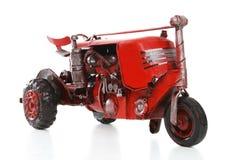 gammal röd retro traktor Royaltyfri Foto