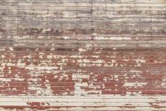 Gammal röd siding för wood hus Royaltyfri Fotografi