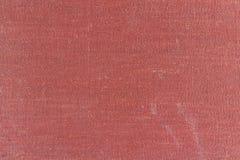 Gammal röd textiltextur med fläckar och att blekna abstrakt bakgrund Arkivbilder