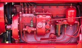 gammal röd traktor för motor Royaltyfri Fotografi