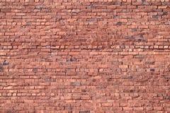 gammal röd vägg för tegelsten Arkivfoto
