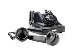Gammal retro bakelitetelefon På en vit bakgrund Royaltyfri Fotografi