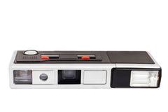 Gammal retro fick- fotokamera på filmen som isoleras på vit bakgrund Arkivfoton