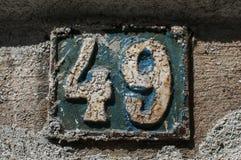 Gammal retro gjutjärnplatta nummer 49 Arkivbild