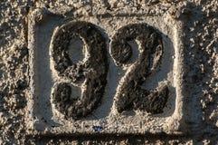 Gammal retro gjutjärnplatta nummer 92 Royaltyfria Foton