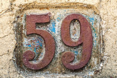Gammal retro gjutjärnplatta nummer 59 Royaltyfria Bilder