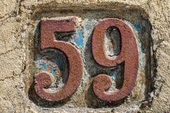 Gammal retro gjutjärnplatta nummer 59 Royaltyfri Foto