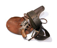 Gammal revolver i en pistolhölster Fotografering för Bildbyråer