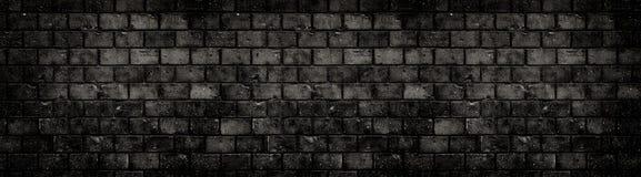 Gammal riden ut grungy svart mörk för tegelstenvägg för konkret kvarter bakgrund för baner för sprickor för hål för hus för textu royaltyfri fotografi