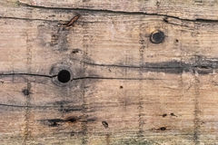 Gammal riden ut sprucken träplankayttersidatextur Arkivbild