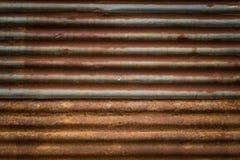 Gammal rost på textur för zinkväggbakgrund Royaltyfri Foto
