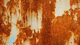Gammal rostig bakgrund för abstrakt begrepp för metallark, rost på det målade red ut stålarket Royaltyfria Foton