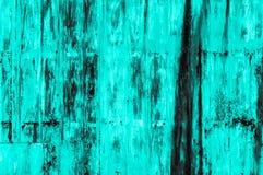 Gammal rostig bakgrund för turkosjärnvägg Arkivfoton