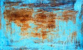 Gammal rostig metalltextur som målas med blått, målar Royaltyfri Foto