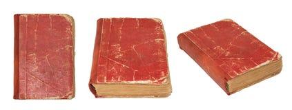 Gammal sönderriven bok som isoleras på vit bakgrund Tappningbok som fotograferas från olika vinklar söndersliten bok Arkivbild