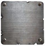 Gammal sönderriven metallplatta med isolerade bultar Royaltyfri Fotografi