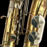 gammal saxofon för detalj Arkivfoto