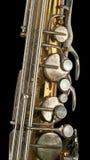 gammal saxofon för detalj Arkivbilder