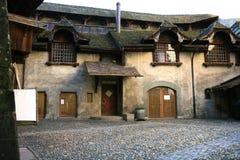 gammal schweizare för borggård Arkivbild