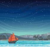 Gammal segelbåt och ö på natthimmel Arkivfoto