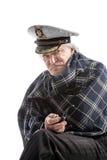 Gammal sjömanman i hatt med röret Royaltyfri Fotografi