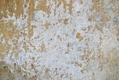 gammal skrapad vägg Arkivfoto