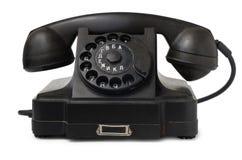 Gammal skrivbords- telefon Arkivfoto
