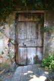 Gammal slitage dörr Fotografering för Bildbyråer