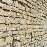 Gammal slotttegelstenvägg Arkivfoto