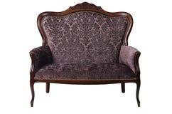 Gammal soffa som isoleras på vit bakgrund royaltyfri bild