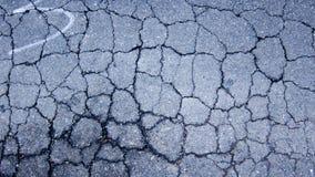 Gammal sprucken asfalttextur Royaltyfri Foto