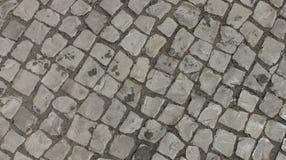 Gammal stentegelstentrottoar Arkivbilder