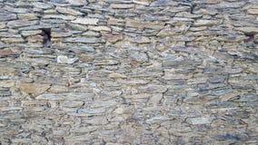 Gammal stenvägg av den naturliga stenen fotografering för bildbyråer
