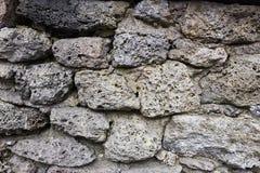 Gammal stenvägg gammal textur för tegelstenar Kvartertextur Arkivfoto