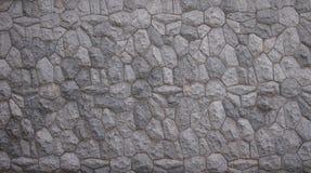 Gammal stenvägg med den blom- modellen Royaltyfri Foto