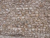 Gammal stenvägg som bakgrund royaltyfria foton