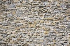 Gammal stenvägg som göras av kalksten och sandsten Royaltyfria Foton