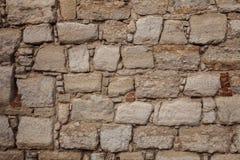 Gammal stenvägg, textur, bakgrund. Arkivfoton