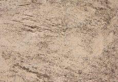 Gammal stuckaturväggtextur av beige färg Arkivbild