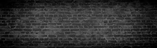 Gammal svart bakgrund för tegelstenvägg Royaltyfri Fotografi