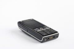 Gammal svart knappmobiltelefon Royaltyfri Foto
