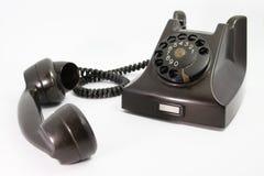 Gammal svart telefon Arkivbild