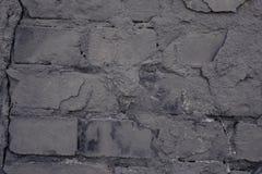 Gammal svart v?gg bakgrundstegelstenclose som skjutas upp grunge arkivbild