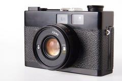 Gammal tappningfotokamera som isoleras på vit Fotografering för Bildbyråer